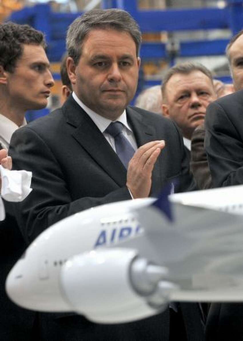 French Labor, Employment and Health Minister Xavier Bertrand looks at an Airbus model during a visit to Aerolia's Meaulte, France factory, for the inauguration of a composite unit that will make the nose fuselage for the Airbus A350 XWB.