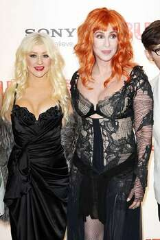 LONDON, ENGLAND - L-R Christina Aguilera and Cher attend the UK Premiere of Burlesque held at The Empire Leicester Square on Monday in London, England. Photo: Getty Images