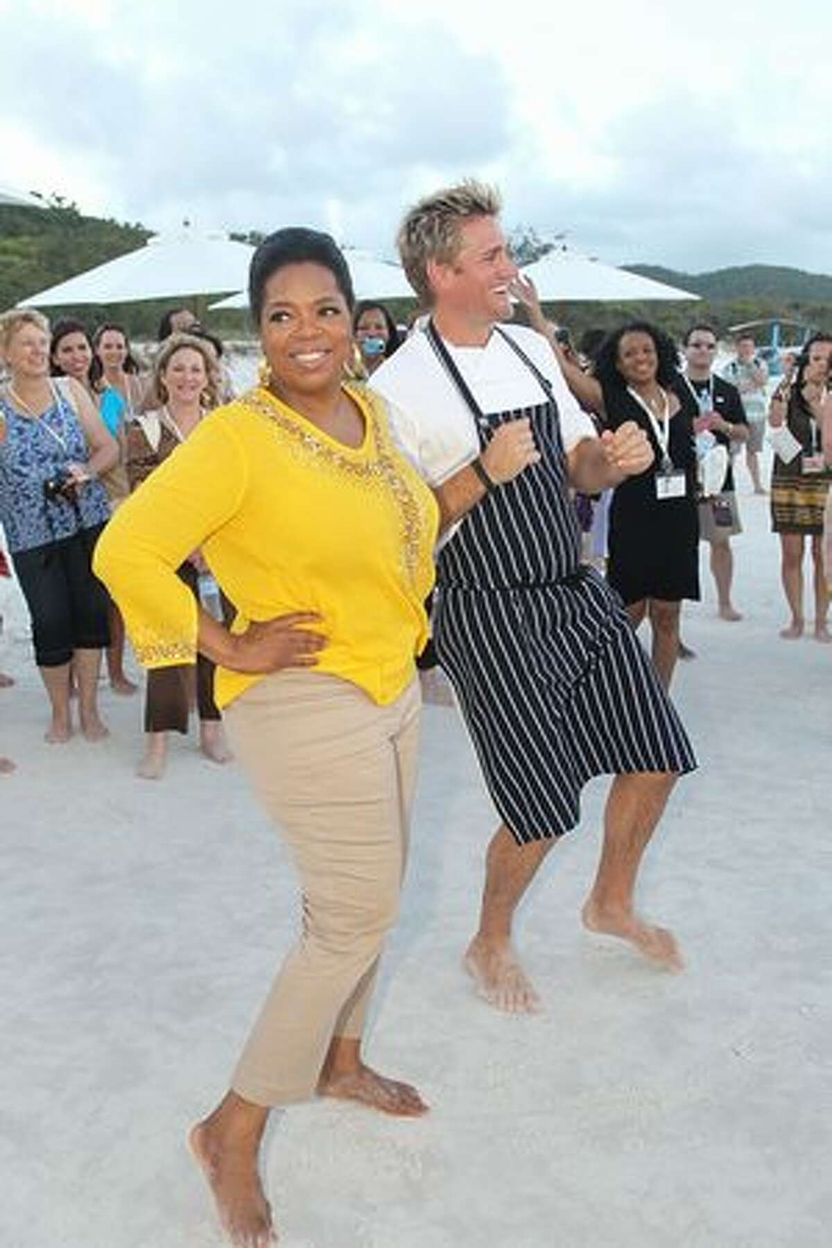 In this handout image provided by Harpo Productions Inc., Oprah Winfrey dances with Chef Curtis Stone on December 8, 2010 on Hamilton Island, Australia. Oprah Winfrey is in Australia with 302 audience members from the US, Canada and Jamaica and will tape episodes of the 25th and final season of 'The Oprah Winfrey Show' from the Sydney Opera house next week. The shows will air in the US and Australia in January 2011.