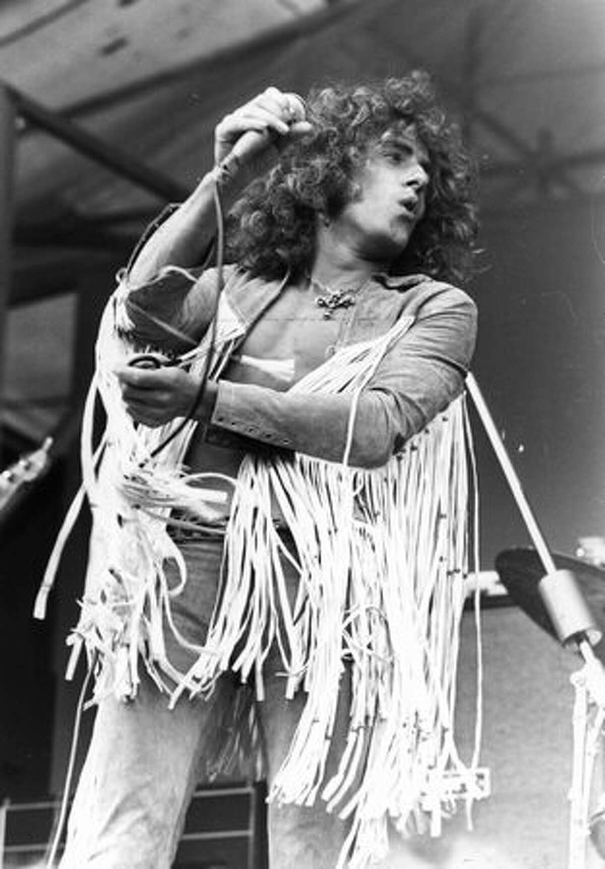 Singer Roger Daltrey performing with rock group the Who at the Isle of Wight Festival of Music, 1969.