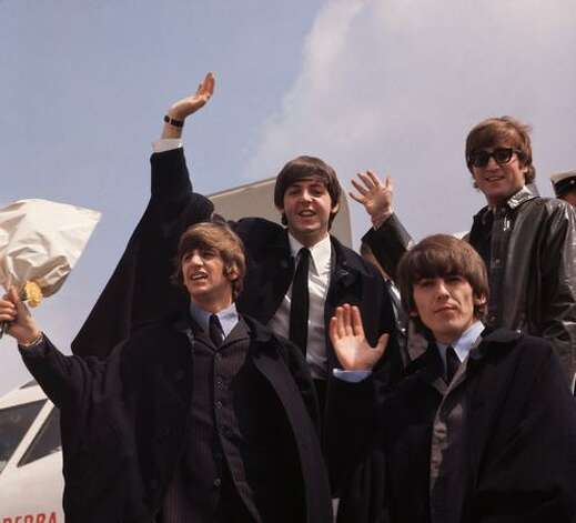 July 2, 1964: The Beatles, John Lennon, George Harrison (1943 - 2001), Paul McCartney and Ringo Starr, pictured on their arrival in London following a tour of Australia. Photo: Getty Images