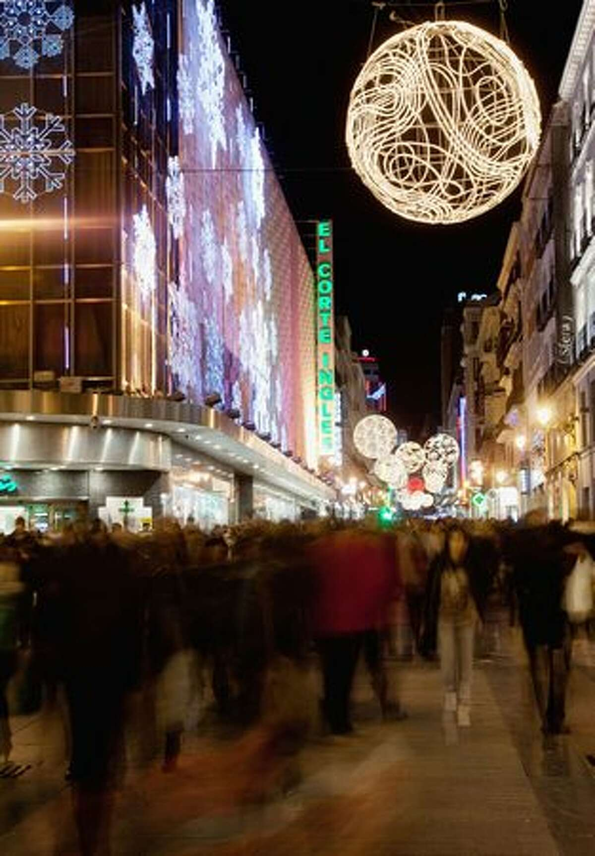 Christmas lights illuminate the calle de Preciados in Madrid, Spain.