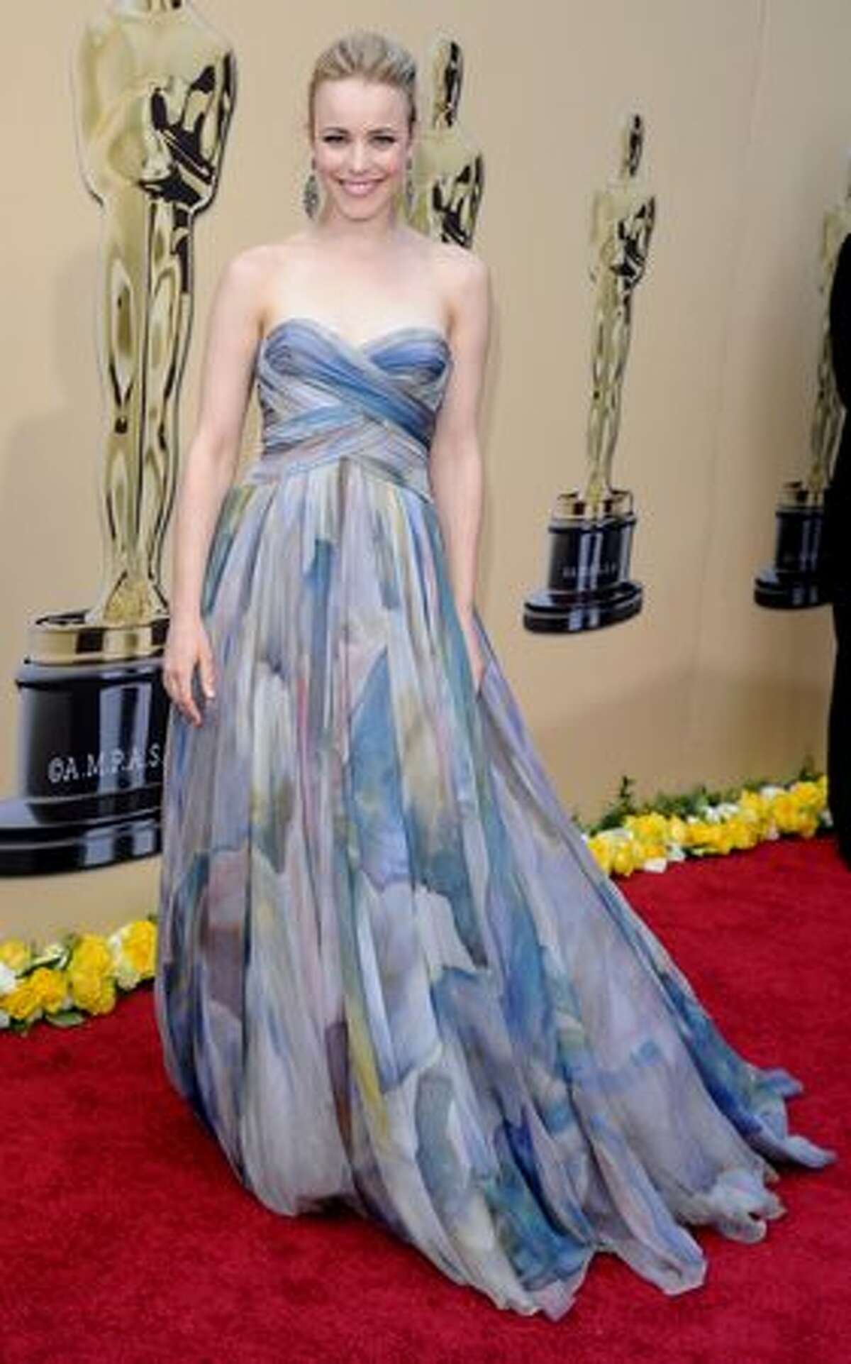 """15. Worst-dressed at the 2010 Academy Awards What would the Oscars be without ill-considered fashion statements? Here are our picks from the 2010 event, with commentary like this: """"Rachel McAdams joins the hair-up club and displays curtains from an unknown Holiday Inn Express."""" See the full gallery"""