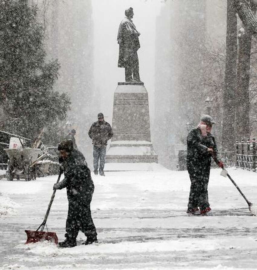Workers shovel snow in Manhattan's Union Square in New York City.