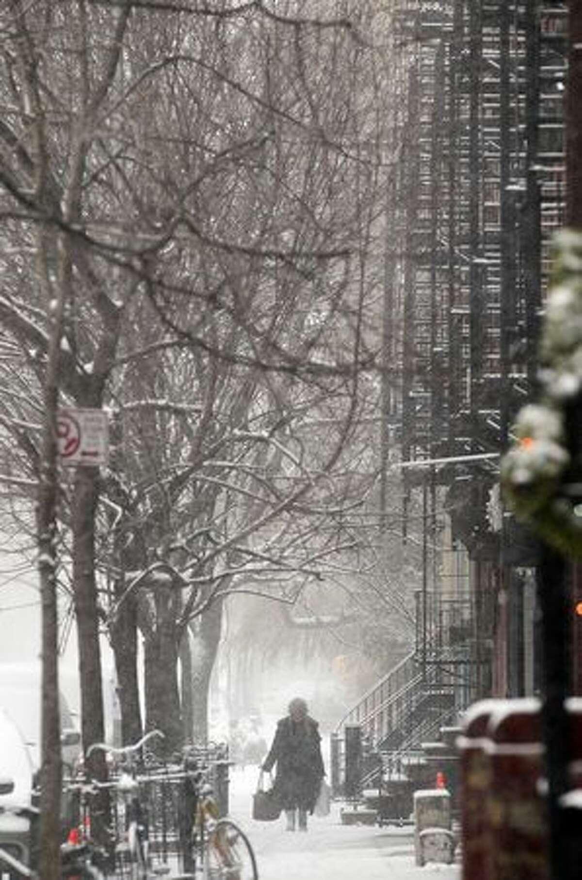 A woman walks through the snow in Manhattan's East Village in New York City.
