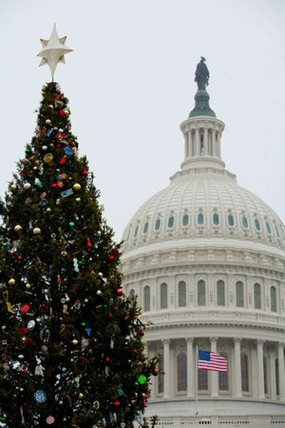 The U.S. Capitol Christmas Tree on in Washington, DC. Initial predictions of heavy snow were downgraded to a dusting as the blizzard passed further to the east.