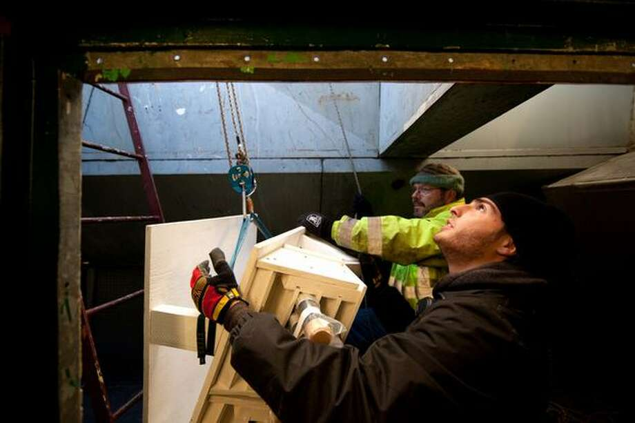 A pyrotechnic crew installs fireworks atop Seattle's landmark Space Needle in preparation for a New Year's show that will welcome in 2011. The crew started the installation early Thursday morning. Photo: Joshua Trujillo, Seattlepi.com