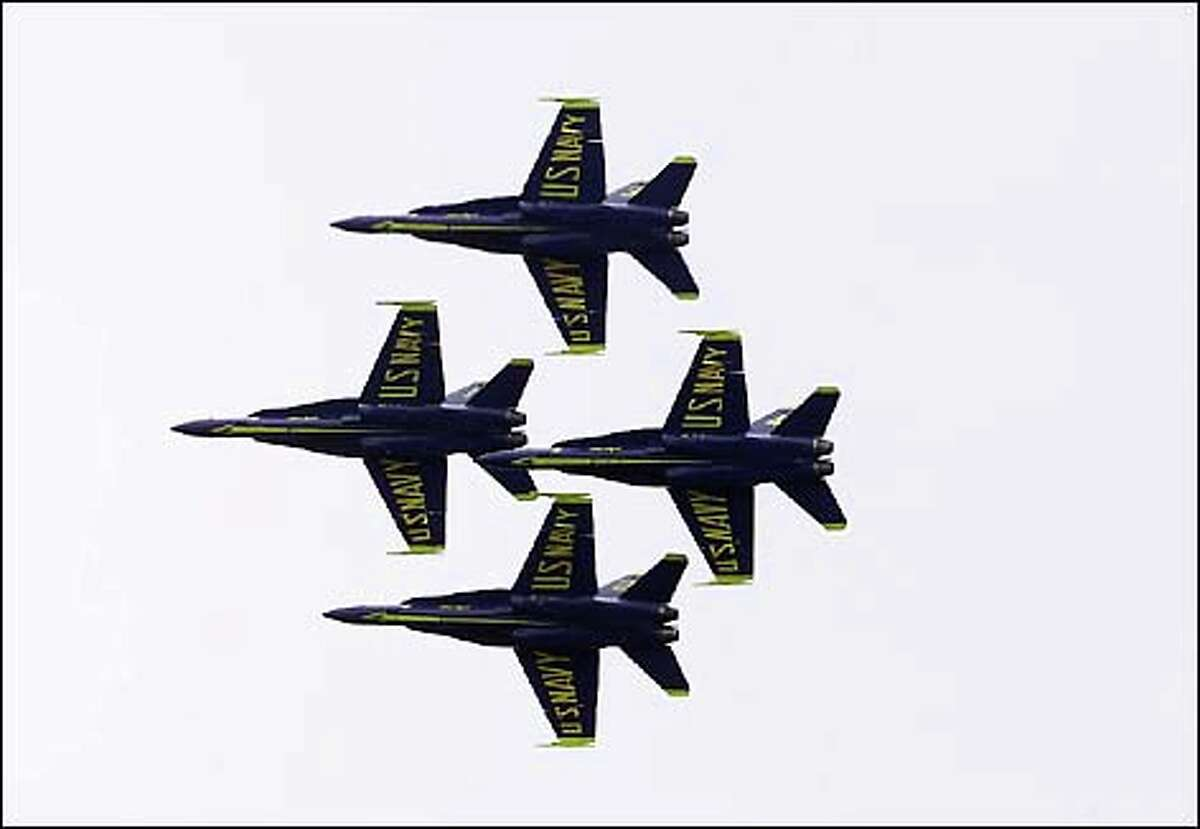 The Blue Angels, the highlight of Seafair for many, streak across the sky. The F-18 fighters buzzed Lake Washington, performing a dazzling array of rolls, spins and turns.
