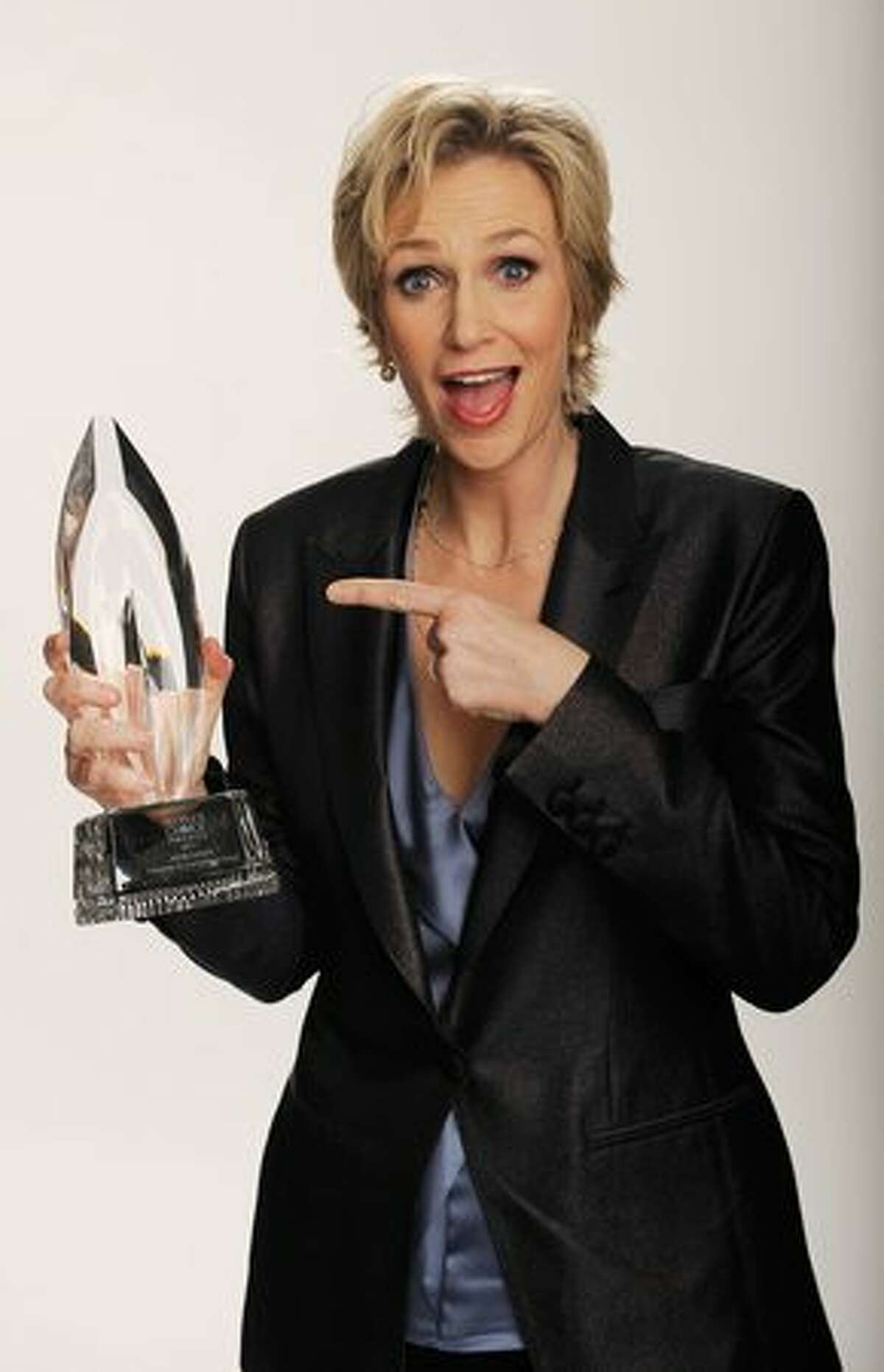 """Actress Jane Lynch, winner of the Favorite TV Comedy award for """"Glee,"""" poses for a portrait."""