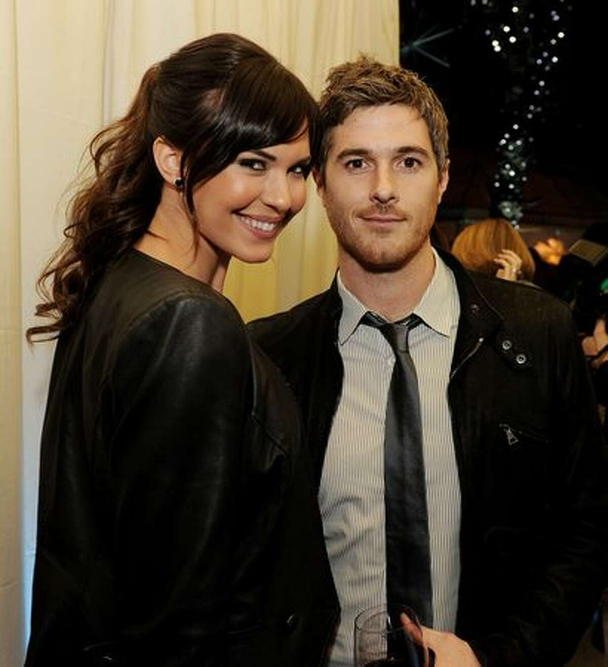Actors Odette Yustman (L) and husband actor Dave Annable pose at Fox TV's TCA All-Star Party at Villa Sorriso in Pasadena, California.