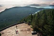 Mt. Constitution on Orcas Island (not on NYT list), the highest point in San Juan Islands, part of 5,000-acre Moran State Park.  Accessible by road or trail, the summit offers vistas of the San Juans, Mt. Baker, and distant Coast Range and Tantalus Mountains in British Columbia. (Robin Layton/Seattle P-I)