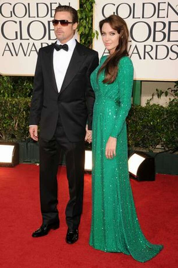 Actor Brad Pitt (left) and actress Angelina Jolie arrive at the 68th annual Golden Globe Awards held at The Beverly Hilton hotel in Beverly Hills, Calif., on Sunday, Jan. 16, 2011. Photo: Getty Images