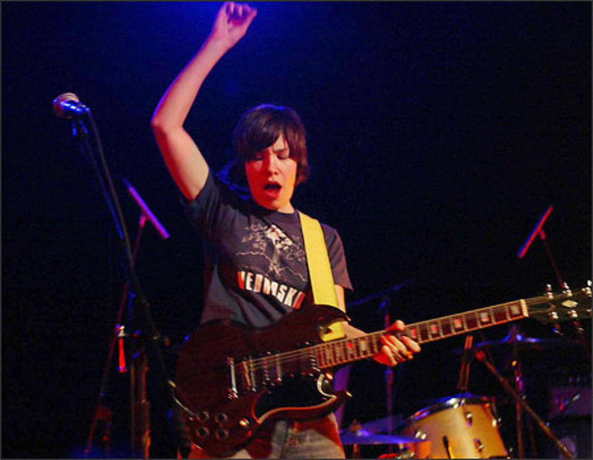 Sleater-Kinney lead guitarist Carrie Brownstein performs during the second of the Olympia band's two shows at The Showbox.