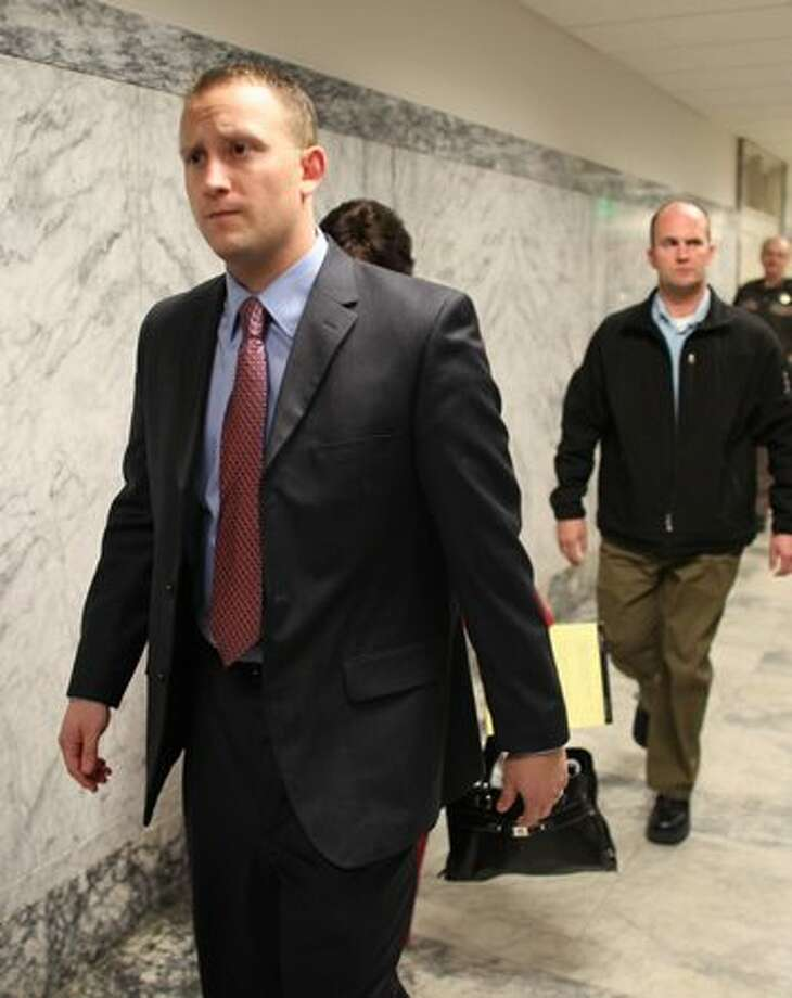 Seattle Police officer Ian Birk, center, walks into the courtroom at the King County Courthouse in Seattle. Seattle Police Officer Ian Birk sat before an inquest jury after shooting and killing Native American woodcarver John T. Williams last August. Photo: Joshua Trujillo, Seattlepi.com