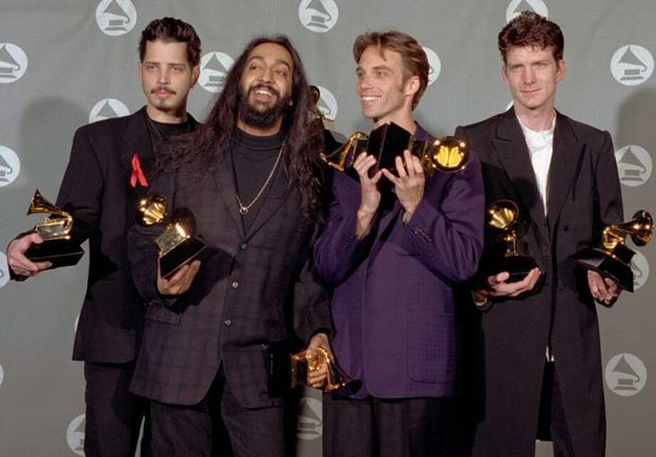 "The Seattle-based group Soundgarden displays the two Grammys they won for Hard Rock Performance with ""Black Hole Sun"" and Metal Performance with ""Spoonman"" backstage at the Shrine Auditorium during the 37th annual Grammy Awards in Los Angeles Wednesday, March 1, 1995. Photo: Associated Press"