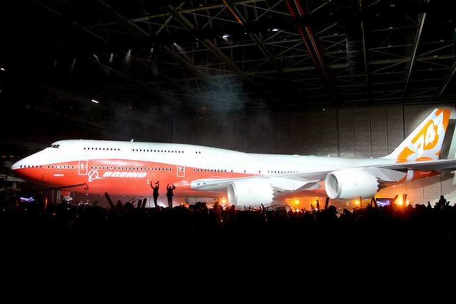 The curtain falls, revealing Boeing's new 747-8 Intercontinental at the Boeing plant in Everett. Photo: Joshua Trujillo, Seattlepi.com