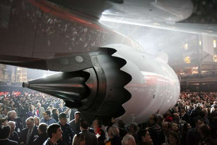 People gather around a General Electric GEnx engine on Boeing's new 747-8 Intercontinental on Sunday during the unveiling ceremony for the new airplane at the Boeing plant in Everett. Photo: Joshua Trujillo, Seattlepi.com