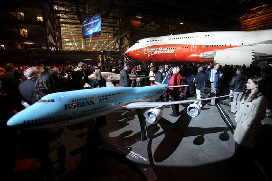 A model of Boeing's new 747-8 Intercontinental is shown in front of the new plane during the unveiling ceremony for the new airplane at the Boeing plant in Everett. Photo: Joshua Trujillo, Seattlepi.com