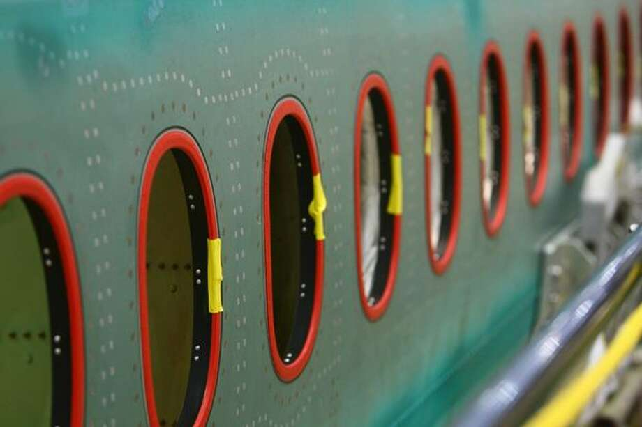 Windows on a 747-8 Intercontinental are shown during a tour of the Boeing 747-8 Intercontinental and Freighter assembly line on Saturday, February 12, 2011 at the Boeing plant in Everett. Photo: Joshua Trujillo, Seattlepi.com