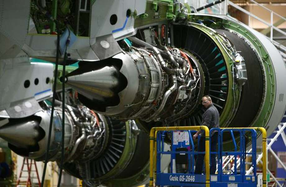 The GEnx engines are shown on a 747-8 during a tour of the Boeing 747-8 Intercontinental and Freighter assembly line on Saturday, February 12, 2011 at the Boeing plant in Everett. Photo: Joshua Trujillo, Seattlepi.com