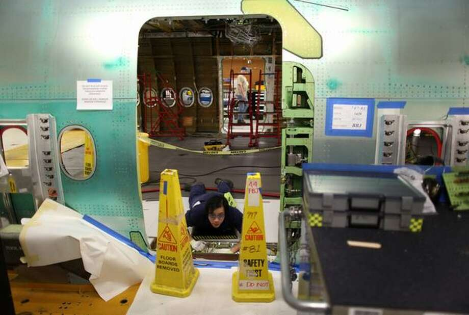 A Boeing employee works on a 747-8 Intercontinental, seen during a tour of the Boeing 747-8 Intercontinental and Freighter assembly line on Saturday, February 12, 2011 at the Boeing plant in Everett. Photo: Joshua Trujillo, Seattlepi.com