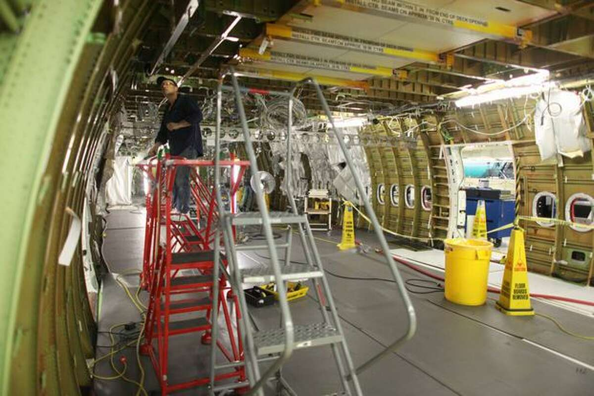 A Boeing employee works on a 747-8 Intercontinental, seen during a tour of the Boeing 747-8 Intercontinental and Freighter assembly line on Saturday, February 12, 2011 at the Boeing plant in Everett.