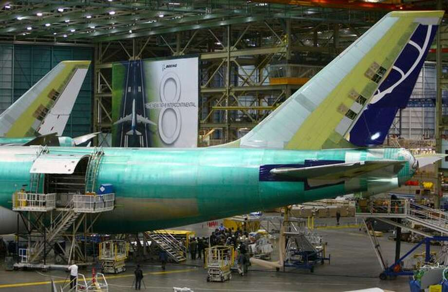 The tails of a pair of 747-8 Freighters are shown during a tour of the Boeing 747-8 Intercontinental and Freighter assembly line on Saturday, February 12, 2011 at the Boeing plant in Everett. Photo: Joshua Trujillo, Seattlepi.com