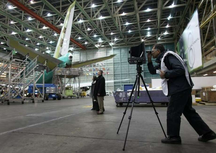 Photographer Ramak Fazel uses a view camera to photograph aircraft during a tour of the Boeing 747-8 Intercontinental and Freighter assembly line on Saturday, February 12, 2011 at the Boeing plant in Everett. Photo: Joshua Trujillo, Seattlepi.com