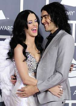Singer Katy Perry arrives with her husband comedian Russell Brand for the 53rd annual Grammy Awards at the Staples Center in Los Angeles. Photo: Getty Images