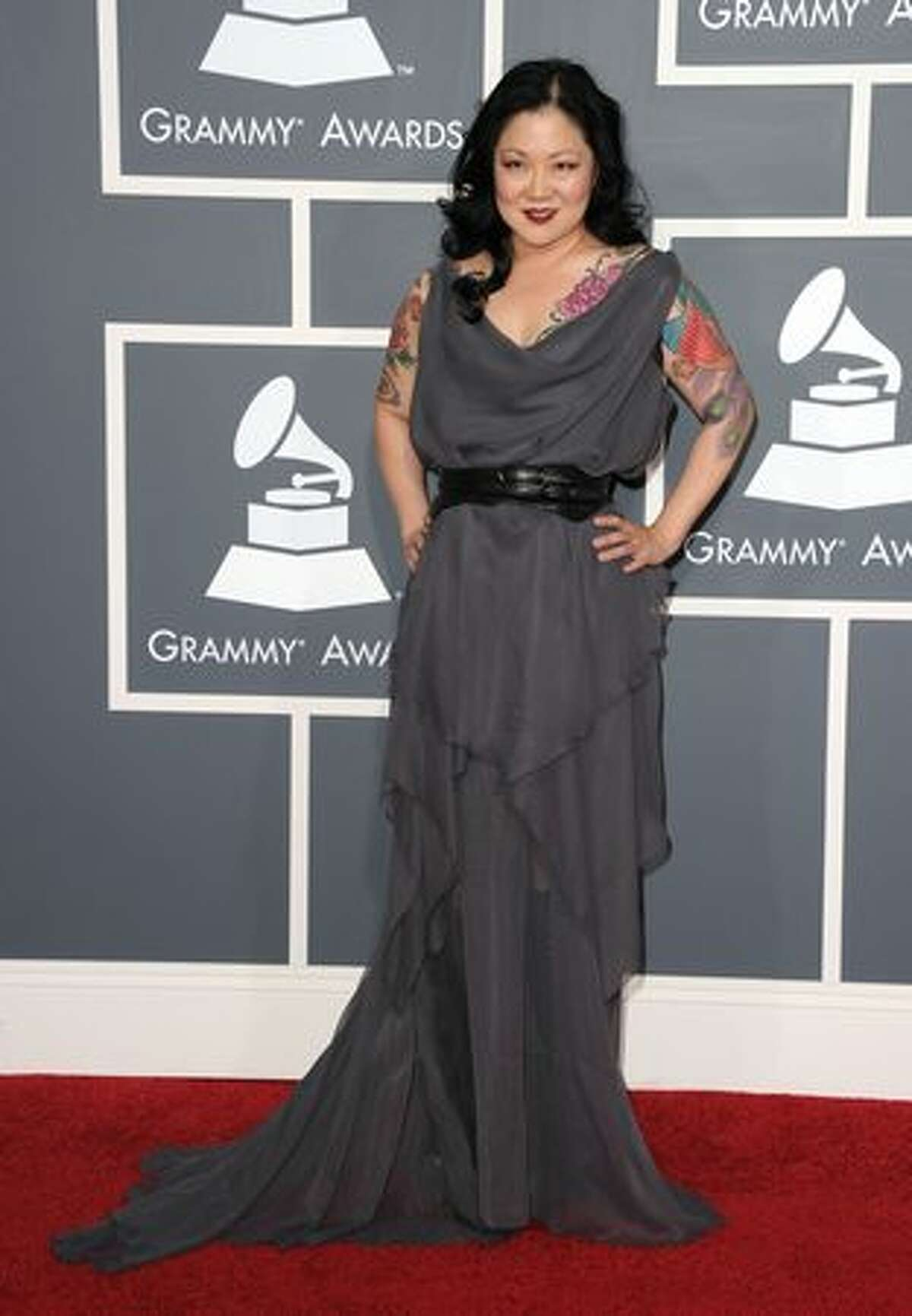 Comedian Margaret Cho is probably the last person we would have expected to see at the Grammys, much less on this best-dressed list. Plus, we don't like tattoos. But her choice of dress is beautifully flattering, especially considering her 5-foot-5 frame, and her colorful tats actually enhance the monochromatic gown. BTW, that's a great belt.