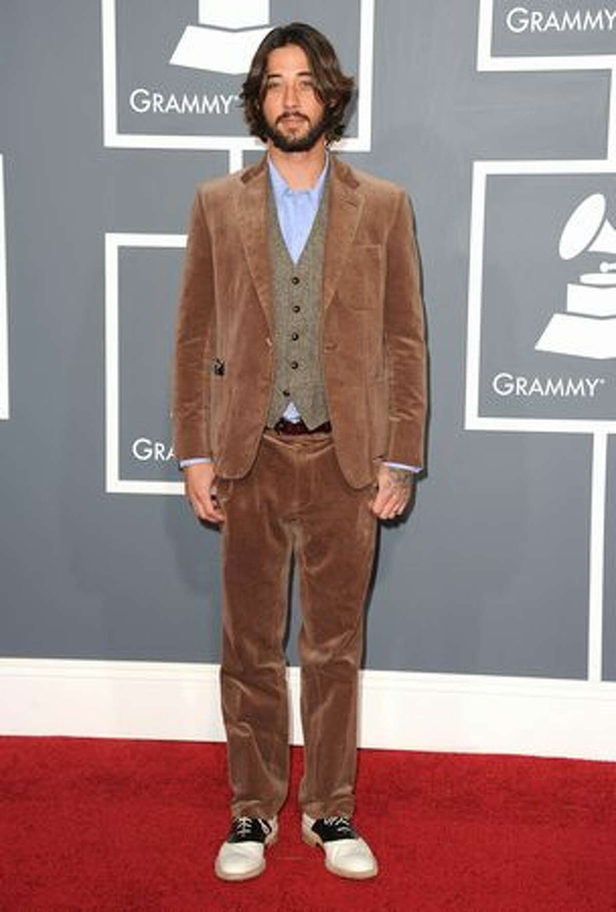 Musician Ryan Bingham is wearing corduroy, velour and bowling shoes. We think. Can't bear to look anymore.