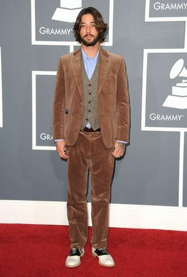 Musician Ryan Bingham is wearing corduroy, velour and bowling shoes. We think. Can't bear to look anymore. Photo: Getty Images