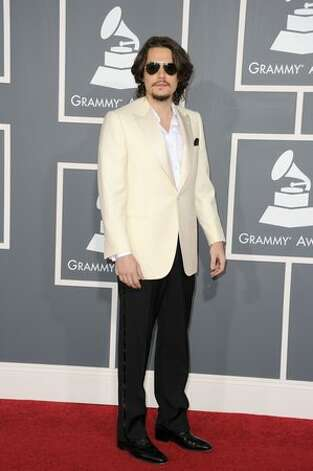John Mayer went to Men's Wearhouse, rented the oldest pair of tux pants and dress shoes they had, found one of his dad's old country club jackets in the back of a closet and declared himself ready to go to the Grammys. Photo: Getty Images