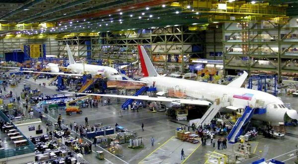 The sixth Boeing 787 Dreamliner for Air India is shown in assembly, in front of a 787 for Japan Airlines, at Boeing's wide-body plant in Everett, Wash.