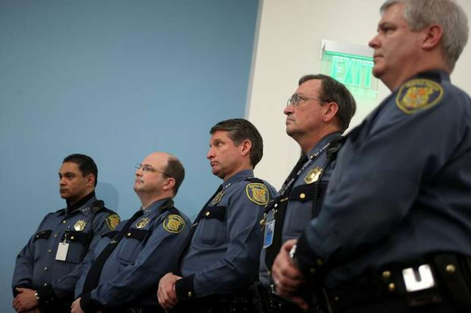 From left, Seattle Police Department Assistant Chief Nick Metz, Asst. Chief Dick Reed, Asst. Chief Jim Pugel, Captain Dick Belshay and Capt. Paul McDonagh listen as Chief John Diaz addresses reporters at Seattle Police Headquarters regarding Officer Ian Birk on Wednesday. Photo: Joshua Trujillo, Seattlepi.com