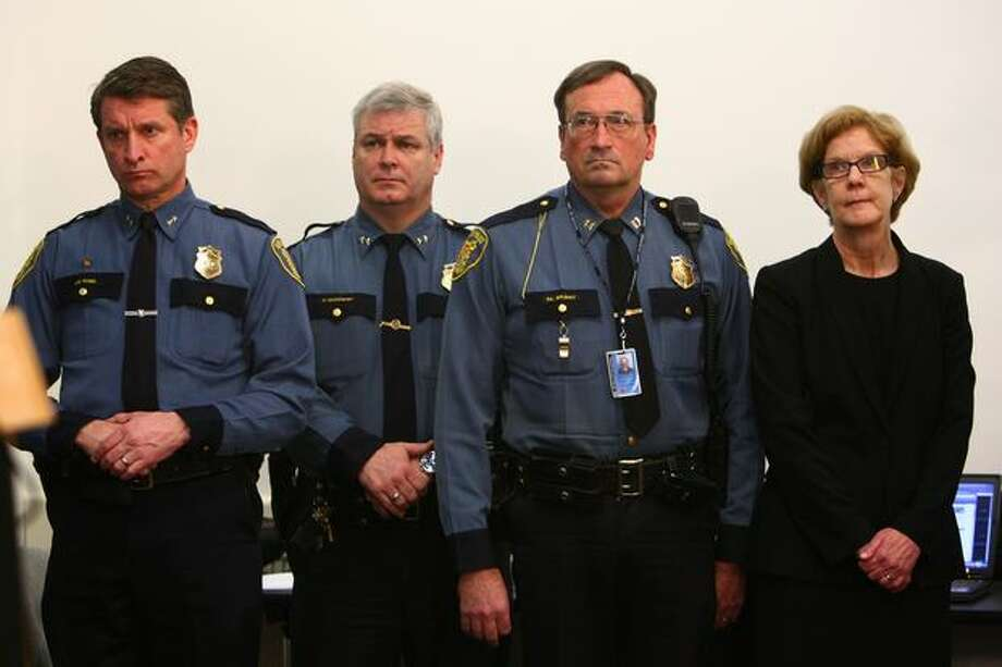 From left, Seattle Police Department Assistant Chief Jim Pugel, Assistant Chief Paul McDonagh, Captain Dick Belshay and Office of Professional Accountability Director Kathryn Olson listen as Chief John Diaz addresses reporters regarding Officer Ian Birk on Wednesday. Photo: Joshua Trujillo, Seattlepi.com