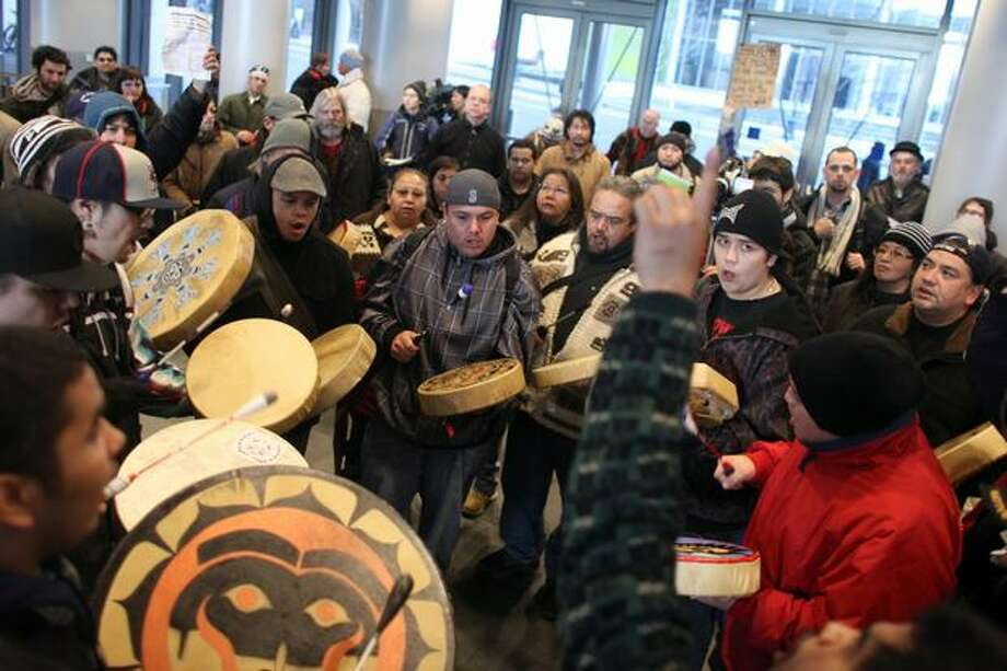 Native drummers perform a song honoring John T. Williams inside Seattle City Hall after it was announced earlier in the day that Seattle Police Officer Ian Birk will not face prosecution. Photo: Joshua Trujillo, Seattlepi.com