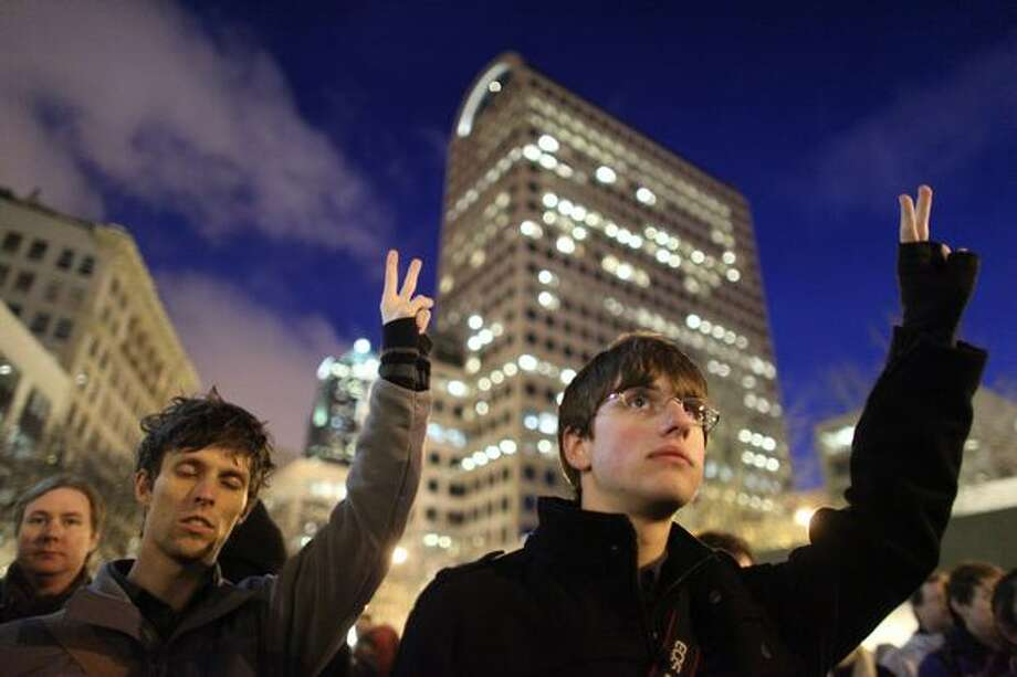 Protesters observe a moment of silence at Westlake Park. Photo: Joshua Trujillo, Seattlepi.com