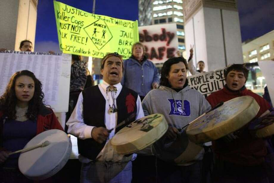 Protesters perform a prayer song at Westlake Park before a march. Photo: Joshua Trujillo, Seattlepi.com