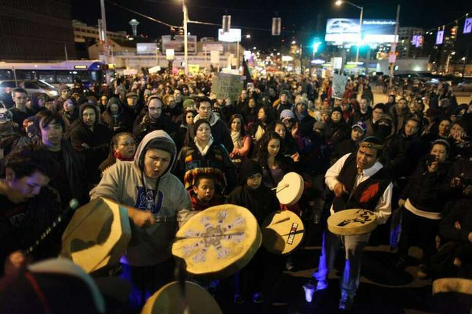 Native drummers sing at the site where John T. Willams was killed after it was announced earlier in the day that Seattle Police Officer Ian Birk will not face prosecution. Photo: Joshua Trujillo, Seattlepi.com