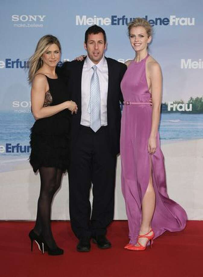 (L-R) Actress Jennifer Aniston, actor Adam Sandler and actress Brooklyn Decker attend the 'Just Go With It' Germany premiere at CineStar in Berlin, Germany. Photo: Getty Images