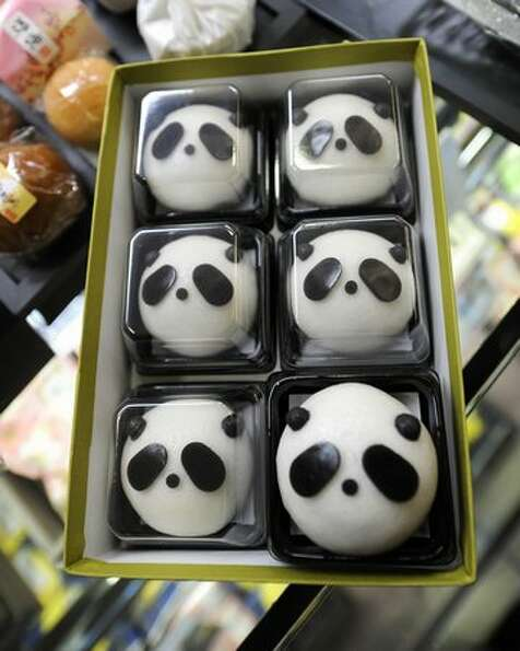 Panda-shaped manju, buns stuffed with adzuki-bean paste, are displayed in Tokyo on February 21, 2011