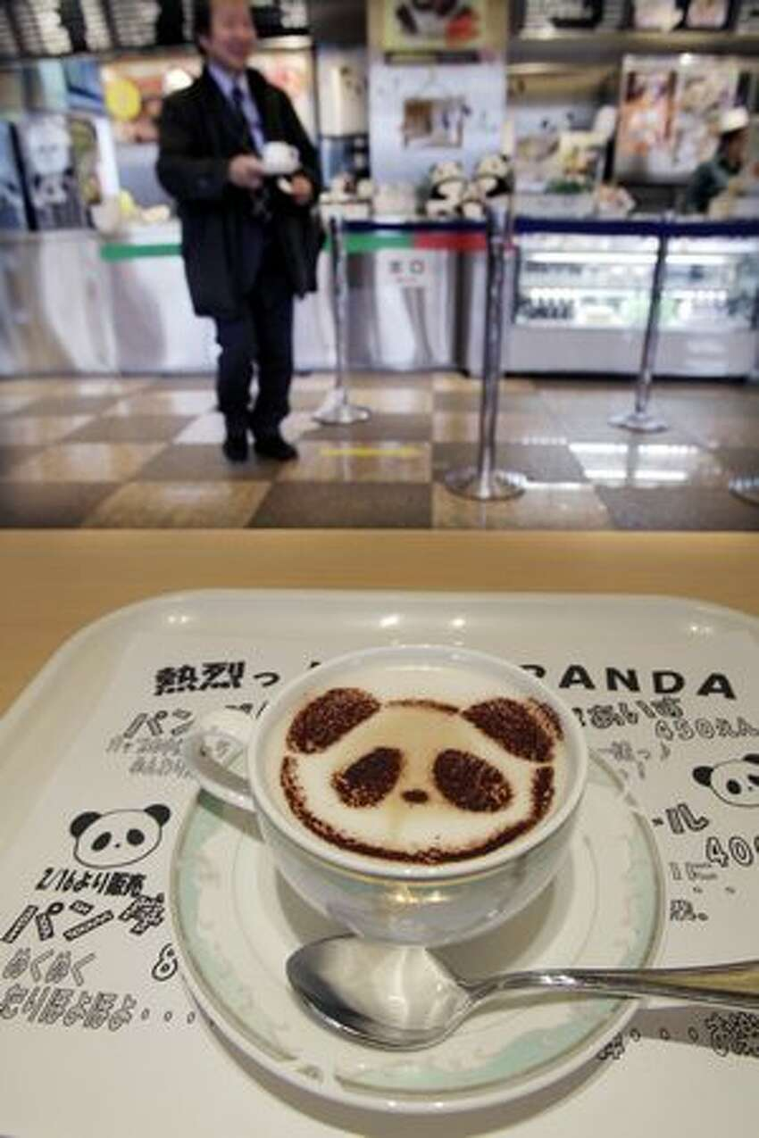 Panda latte is offered at Ueno Green Saloon restaurant in Tokyo's Ueno district Friday, Feb. 18, 2011. Shops, restaurants and people in the area near Tokyo's Ueno Zoo are getting ready to welcome two giant pandas arriving Monday, Feb. 21 to the zoo from China on a 10-year loan, the latest installment of panda diplomacy aimed at warming the two countries' often-strained relations. (AP Photo/Koji Sasahara)