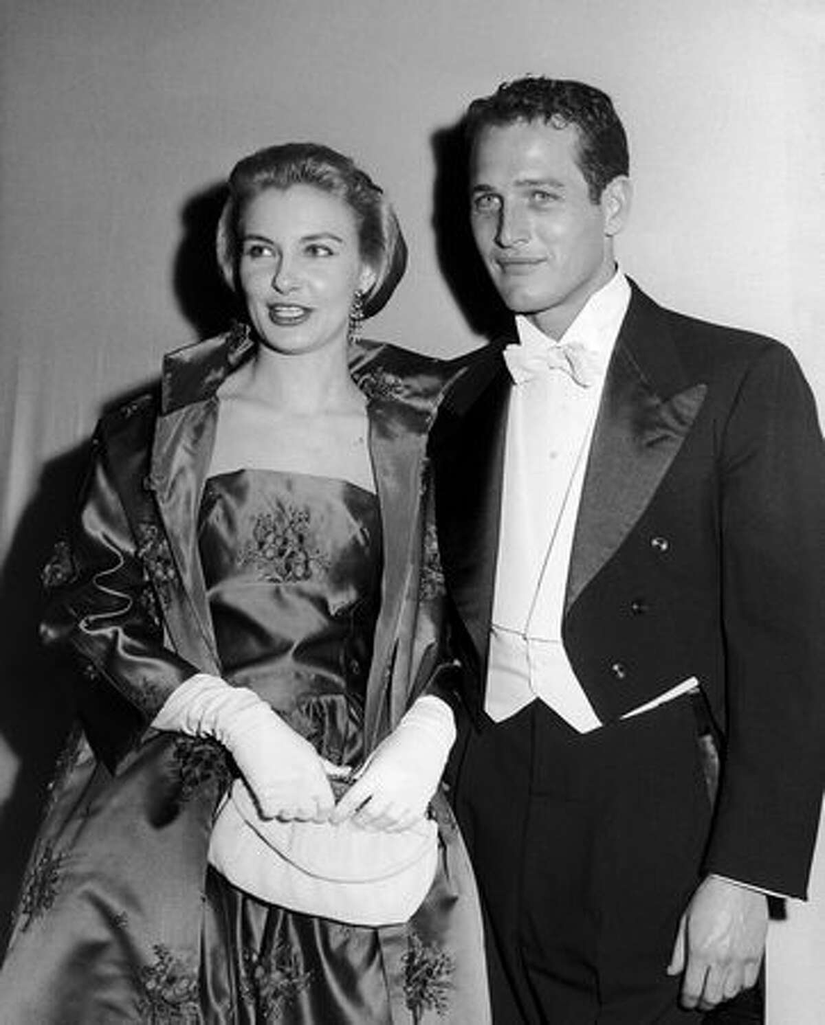 1964: Married actors Paul Newman (1925 - 2008) and Joanne Woodward pose together at the Academy Awards in California.