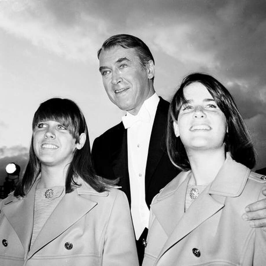 1967: Actor James Stewart (1908 - 1997) attends the Academy Awards with his twin daughters Kelly and Judy, Santa Monica, Calif. Photo: Getty Images