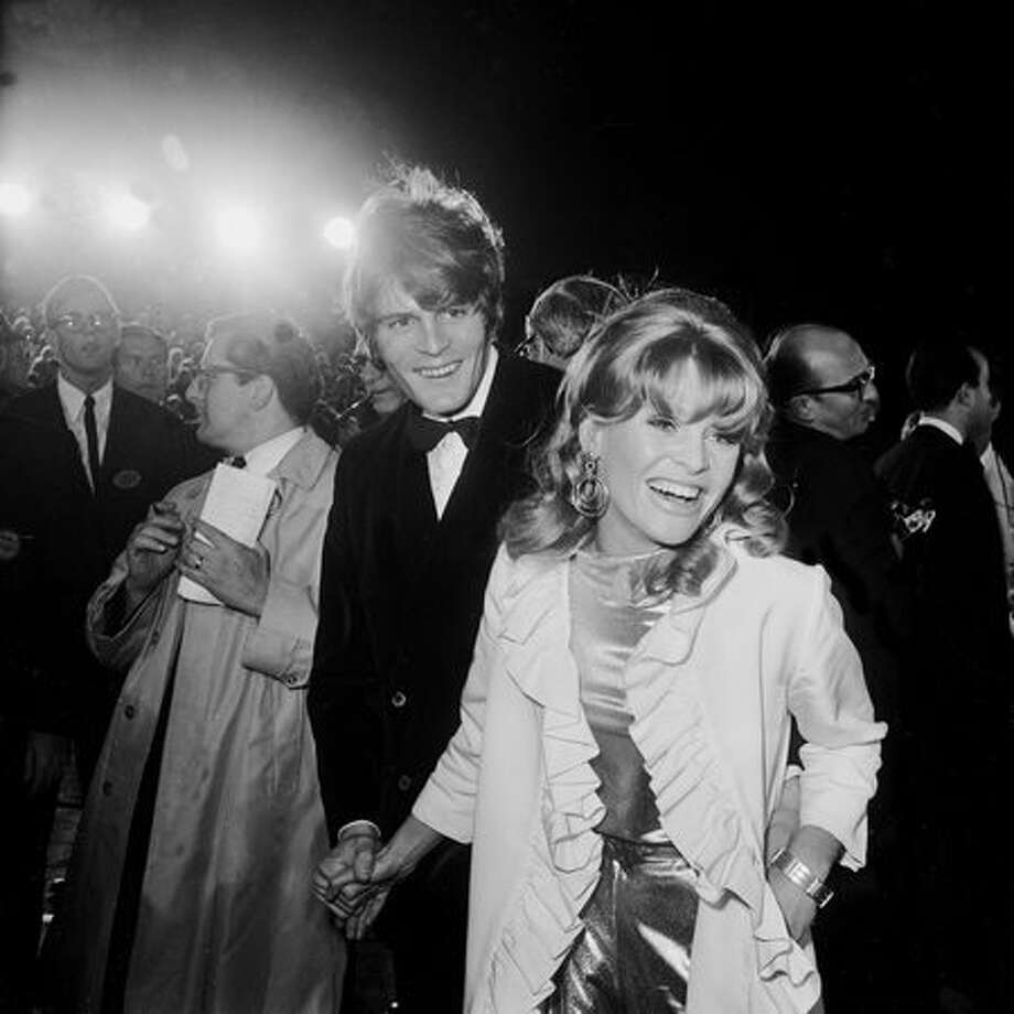 "1966: Actress Julie Christie and her date, Don Bessant, arrive at the Academy Awards in Santa Monica, Calif. Christie won Best Actress for her role in the film ""Darling,"" directed by John Schlesinger. Photo: Getty Images"