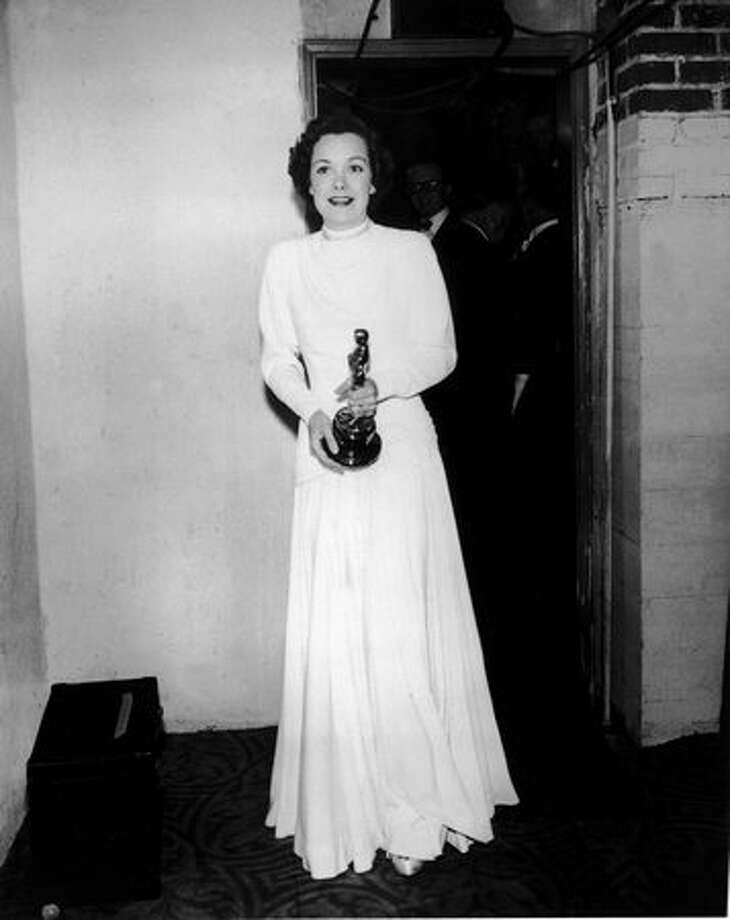 "1949: Actress Jane Wyman carrying her Oscar for Best Actress, for her role in ""Johnny Belinda,"" at the Academy Awards in Hollywood. Photo: Getty Images"