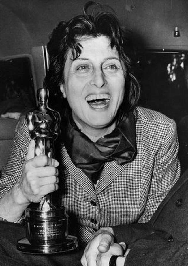 "1956: Italian actress Anna Magnani (1907 - 1973) holding the Oscar she won for her performance in ""The Rose Tattoo,"" presented to her by U.S. Ambassador Clare Luce at the Villa Taverna in Rome. Photo: Getty Images"