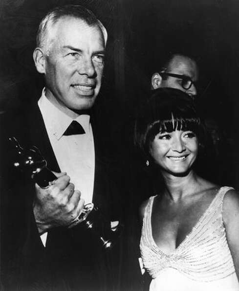 1966: Actor Lee Marvin (1924 - 1987) with Michelle Triola (1932 - 2009), holding the Academy Award O