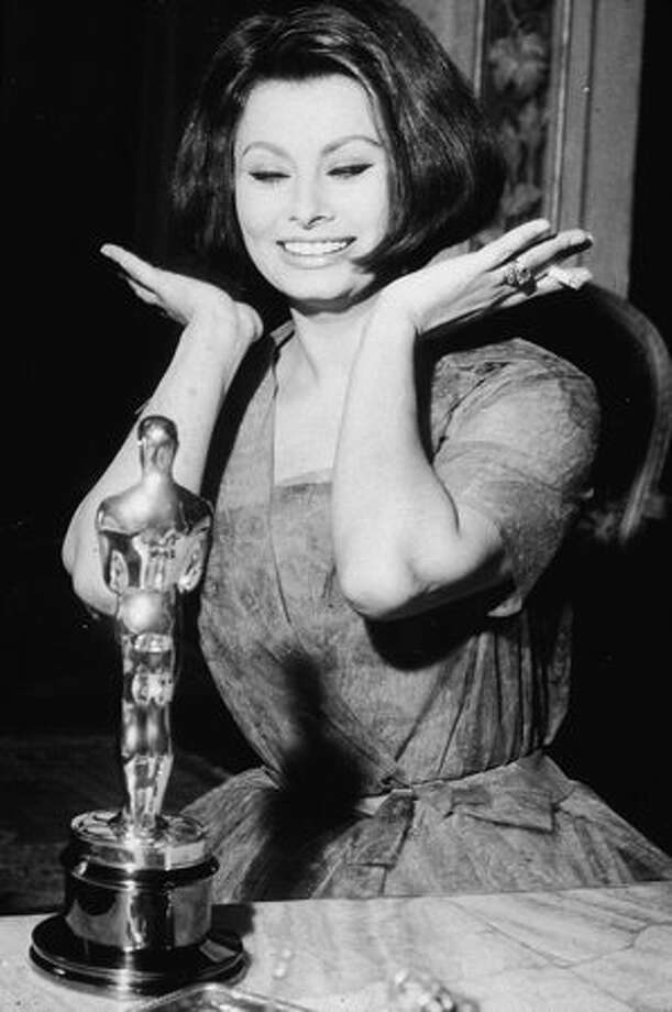 "1962: Sophia Loren reacts after winning the Best Actress Oscar for the film ""La Ciociara."" Photo: Getty Images"